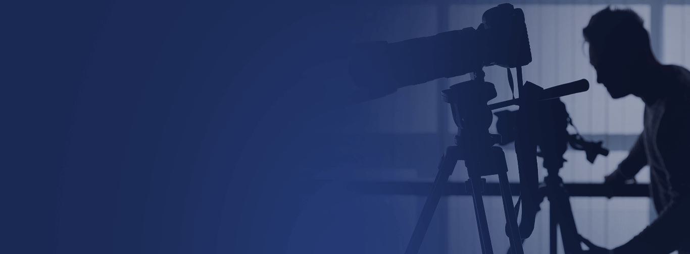 silhouette of cameraman and two cameras