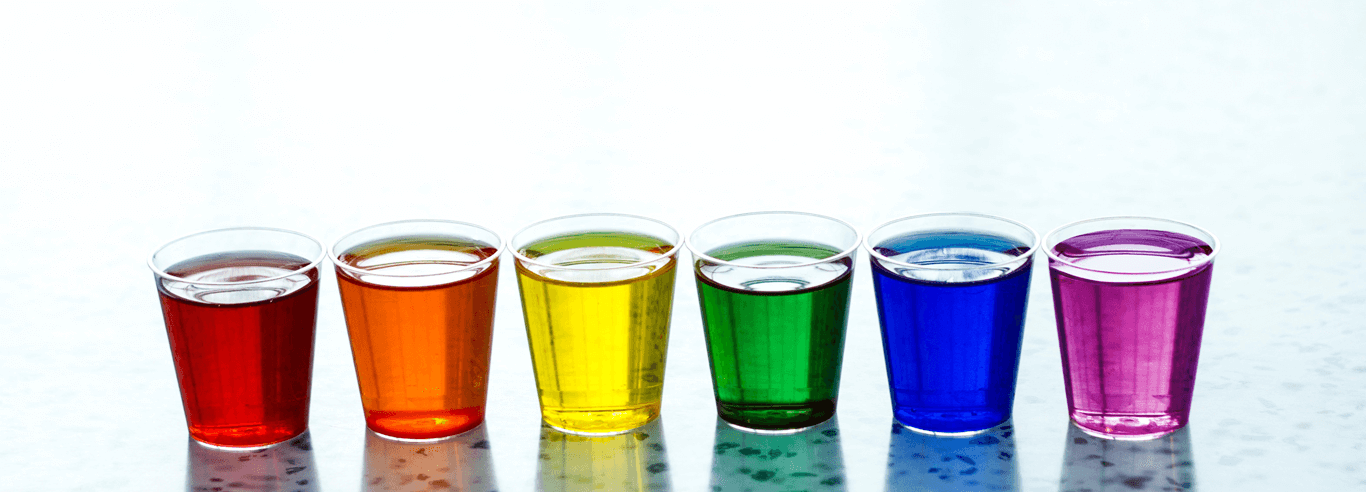 cups containing multi-colored liquid