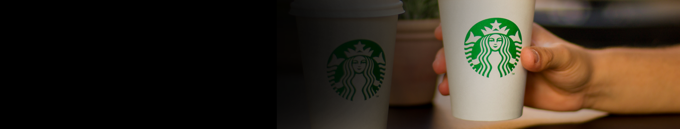 hand holding white starbucks cup